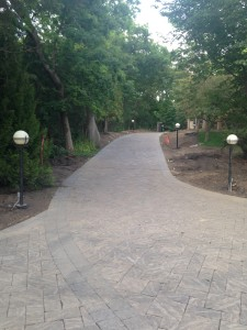 Brick driveway and landscaping